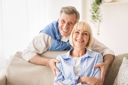 Photo pour Love lives forever! Senior man hugging wife and spending time together at home - image libre de droit