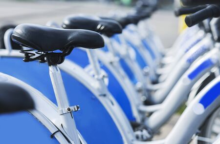 Photo for Bicycles for rent in city, station with new similar bikes outdoor, close up - Royalty Free Image