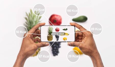 Photo for Woman holding cellphone with application which counting calories by photo, background, panorama - Royalty Free Image