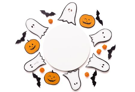 Photo for Halloween background for advertisement on round copy space, paper ghosts, bats and pumpkins on white - Royalty Free Image