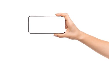 Photo for Womans hand holding modern smartphone with blank screen in horizontal orientation, panorama with copy space - Royalty Free Image