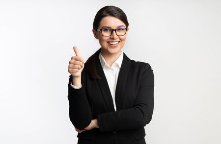 Photo for Like. Smiling Businesswoman Gesturing Thumbs Up Standing Over White Background. Studio Shot - Royalty Free Image