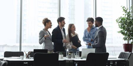 Foto für Diverse management team talking in conference room, discussing ideas against office windows, panorama - Lizenzfreies Bild