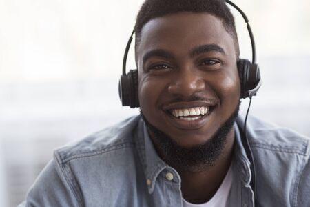 Foto de Customer Service Operator. Portrait of joyful african american call center manager in headset, closeup - Imagen libre de derechos