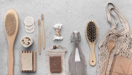 Photo pour Zero waste supplies for personal hygiene. Bamboo bath accessories and eco soap on gray background - image libre de droit