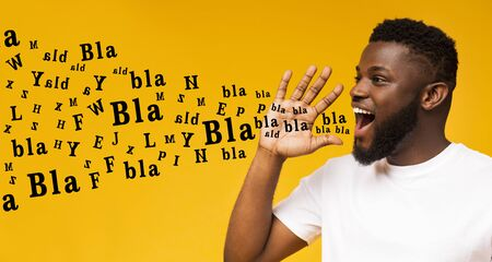 Photo for Bla bla bla. Handsome black guy shouting at copy space, making announcement with alphabet letters coming out of his mouth, yellow background, panorama - Royalty Free Image