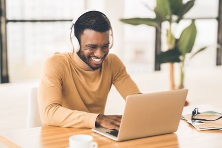 Photo for Break Time. Happy black student in headset watching video online, chatting with friends. Copy space - Royalty Free Image