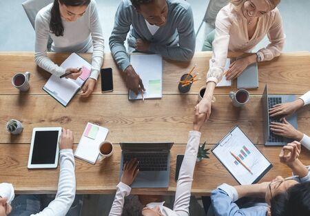 Foto de Top view of multiracial creative team having business meeting in office, working atmosphere concept - Imagen libre de derechos
