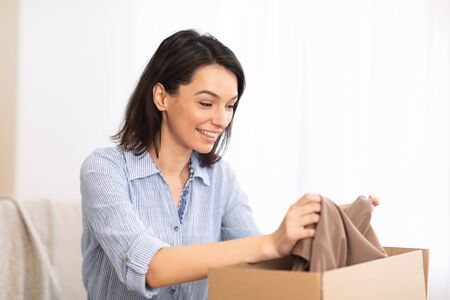 Photo for Delivery, Shipping And Postal Service Concept. Happy young american woman holding open cardboard box at home - Royalty Free Image
