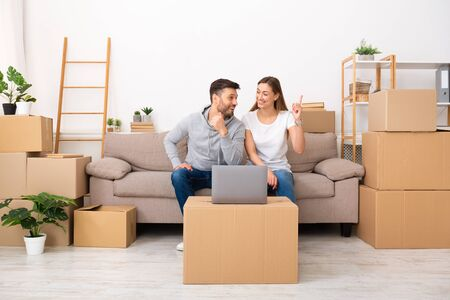 Photo for Home interior design ideas. Happy couple thinking about designer project of new apartment with laptop, copy space - Royalty Free Image