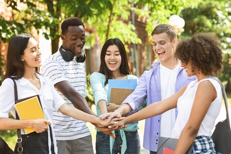 Photo for Education And Unity Concept. Group Of International Students Stacking Hands Together Outdoors In College Campus, Celebrating Success - Royalty Free Image