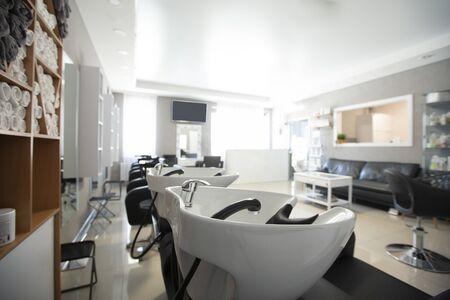 Foto de Focus on sink for washing hair. Beauty salon inside - Imagen libre de derechos