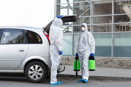 Photo pour Stay at home. Man in hazmat suits buying disinfection spray for home cleaning, epidemic, quarantine, copy space - image libre de droit