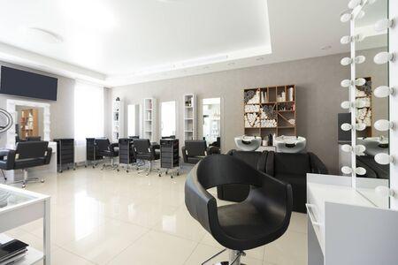 Foto de Barber chair for client on front background at interior of beauty salon - Imagen libre de derechos