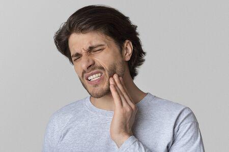 Photo pour Dental problems concept. Man suffering from bad toothache, empty space - image libre de droit