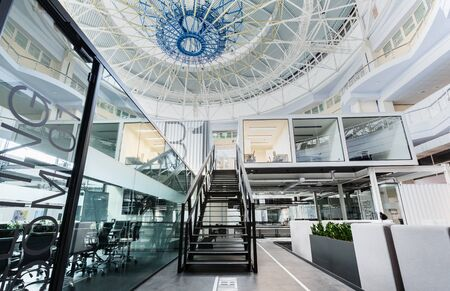 Photo pour Modern open space office with high ceilings and dome, transparent walls - image libre de droit
