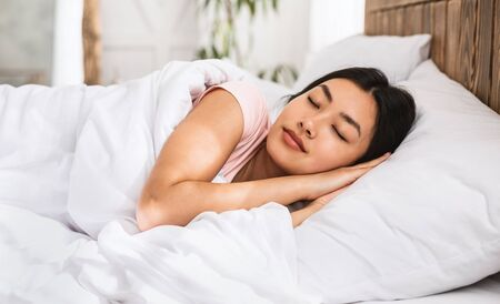 Photo pour Sweet Dreams. Asian Girl Sleeping Well Lying In Cozy Bed In Bedroom Resting At Home - image libre de droit