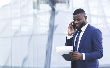 Photo for Business Communication. Cheerful African Businessman Talking On Cellphone Negotiating Deal Standing In Urban Area Outdoors. Copy Space - Royalty Free Image