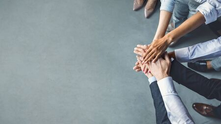 Photo pour Business Team. Unrecognizable Colleagues Holding Hands Standing Together In Modern Office. Cropped, Top View, Free Space - image libre de droit