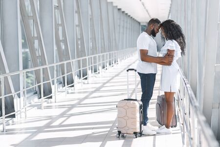 Foto de Post-Quarantine Meeting. Romantic Couple Embracing In Airport Terminal, Happy To See Each Other After Long Lockdown Due To Covid-19, Copy Space - Imagen libre de derechos