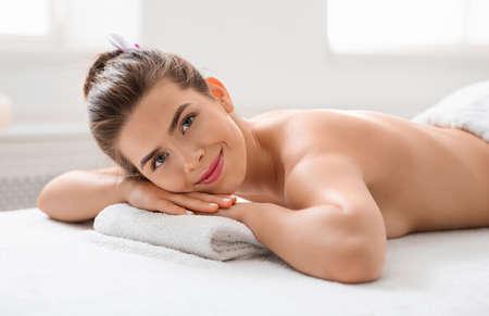 Photo for Joyful lady laying on massage table at spa salon, waiting for massage session - Royalty Free Image
