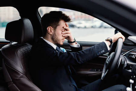 Photo pour Feeling Anxiety. Exhausted, overloaded man closing eyes with hand, experiencing headache or stress - image libre de droit
