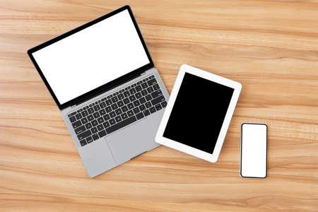 Foto de Set of modern technology devices template for responsive design presentation. Mock up of laptop, phone and tablet - Imagen libre de derechos