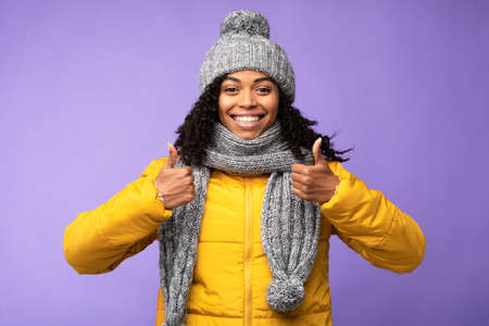 Photo pour Thumbs Up Gesture. African American Lady Gesturing Thumbs-Up With Both Hands Liking And Approving Something Posing Standing Over Purple Studio Background, Smiling To Camera. I Like It Concept - image libre de droit