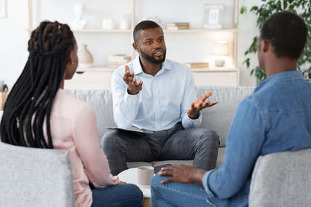 Photo pour Family Psychotherapy. African American Couple Listening To Counselors Advices During Therapy Session In Office, Black Spouses Having Marital Counseling Meeting With Therapist, Selective Focus - image libre de droit