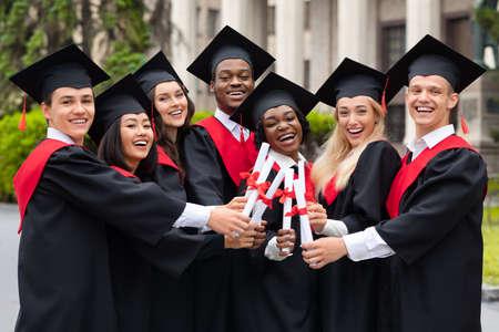 Photo pour Diverse International Students With Diplomas Celebrating Graduation - image libre de droit