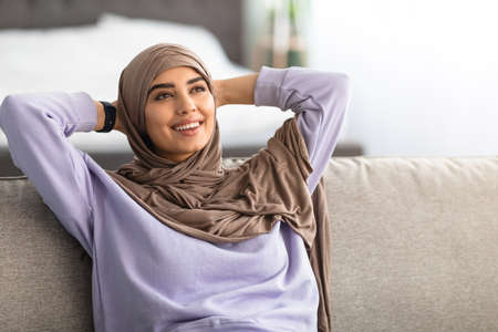 Photo for Muslim woman having rest at home on the weekend - Royalty Free Image