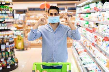 Foto für Arabic Man Wearing Protective Face Mask Buying Food In Supermarket - Lizenzfreies Bild