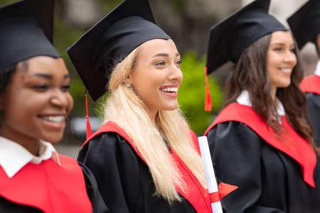 Photo pour Pretty blonde lady standing among international group of students - image libre de droit