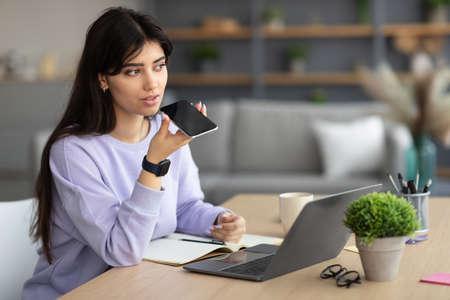 Photo pour Woman using voice search assistant on smart phone - image libre de droit