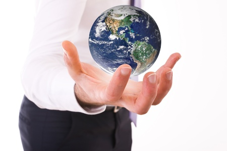 Business man carrying earth