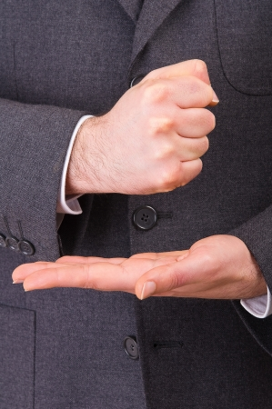 Businessman gesturing with both hands