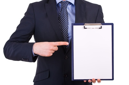 Businessman showing clipboard.
