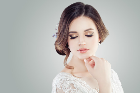 Foto de Cute young woman with makeup, closed eyes - Imagen libre de derechos