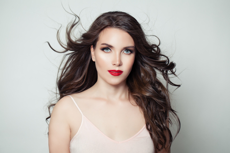Photo for Brunette model woman with long perfect hair and red lips makeup on white background - Royalty Free Image