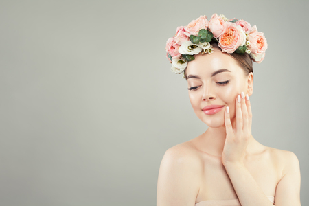 Photo for Young cute woman with healthy skin and flowers. Skin care and facial treatment concept - Royalty Free Image