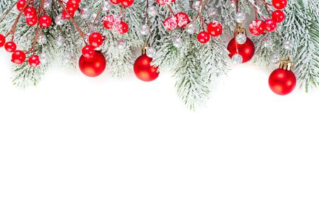 Foto de Christmas concept. Xmas border composition with red glass baubles, holly berries and green fir branch isolated on white background. Xmas flat lay top view - Imagen libre de derechos