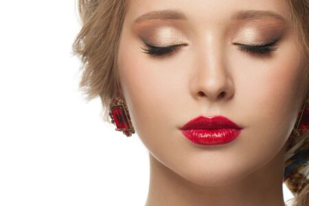 Photo for Beautiful female face close up portrait isolated. Eyes closed, beige eyeshadow makeup and red lips - Royalty Free Image