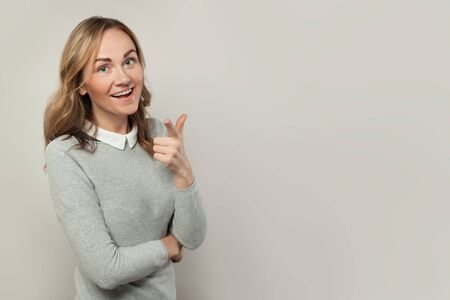 Photo for Attractive woman pointing on white background - Royalty Free Image
