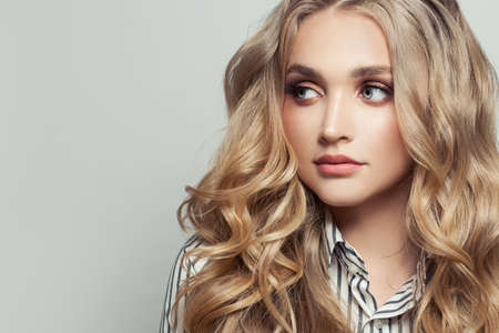 Photo pour Perfect woman with long curly blonde hairstyle on white - image libre de droit