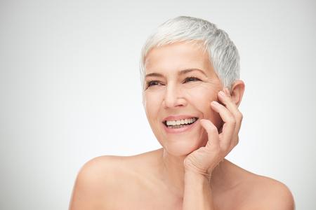 Photo pour Portrait of beautiful senior woman in front of white background. - image libre de droit