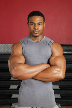 This is an image of a muscular man in the gym.