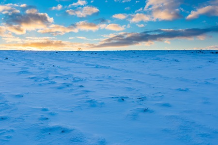 Beautiful winter sunset on fields landscape. Colorful landscape of sunset in winter.
