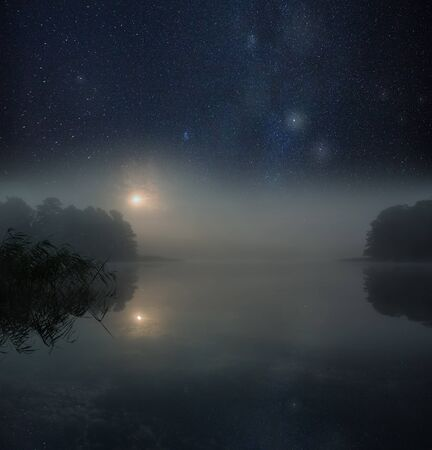 Photo for Nigh spooky landscape with foggy lake under satrry sky. - Royalty Free Image