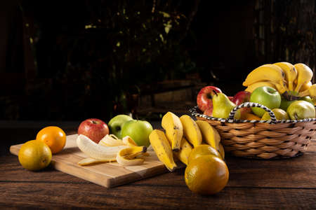 Foto für Peeled banana and apples on polished wood, placed on rustic wood with selective focus. - Lizenzfreies Bild