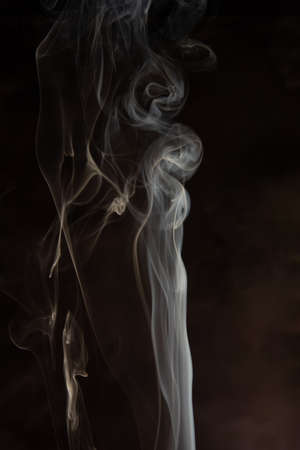 Photo for Smoke, beautiful shapes made by smoke from incense on dark background, selective focus. - Royalty Free Image